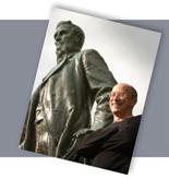 Dan Mansoor with Ezra statue